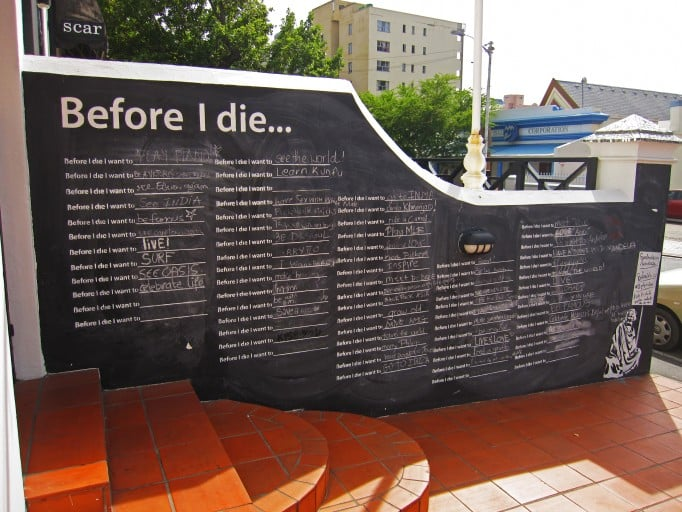 "This wall in Cape Town, South Africa, created in 2012, featured aspirations from ""meet Mr. Mandela"" to ""grow old."" Photo courtesy of BeforeIDie.com"