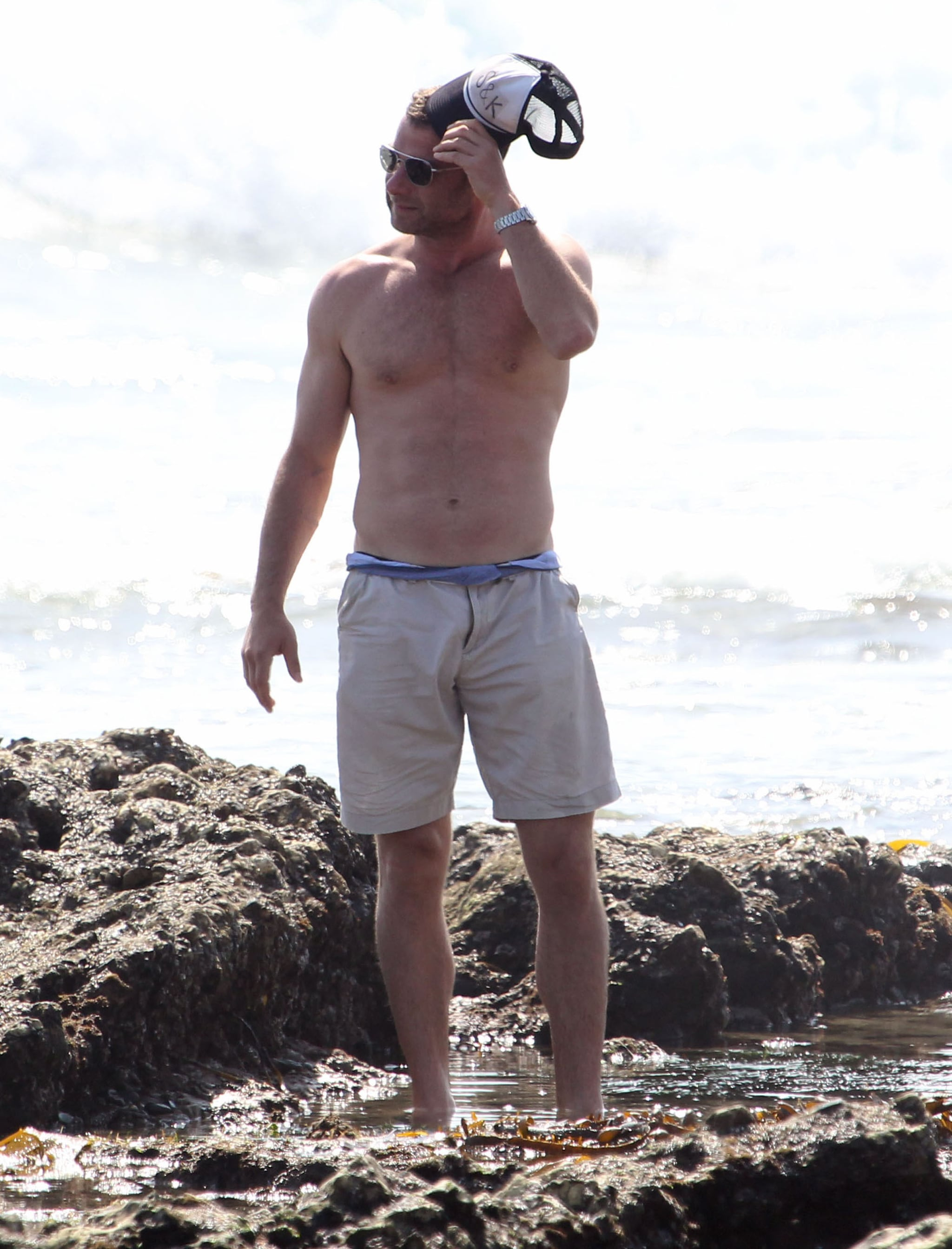Liev Schreiber checked out Malibu tide pools shirtless in March.