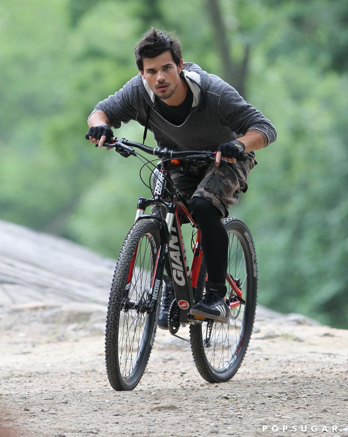 Taylor Lautner pedaled on a dirt path while filming Tracers in NYC this past June.