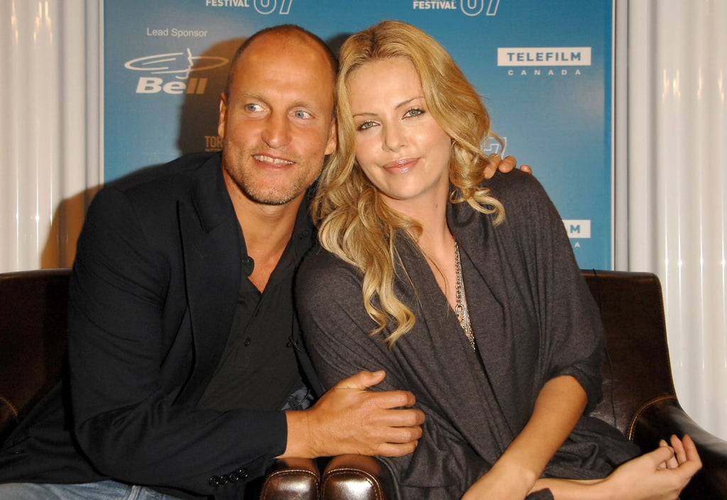 Woody Harrelson and Charlize Theron stuck close during the 2007 press conference for Battle in Seattle.