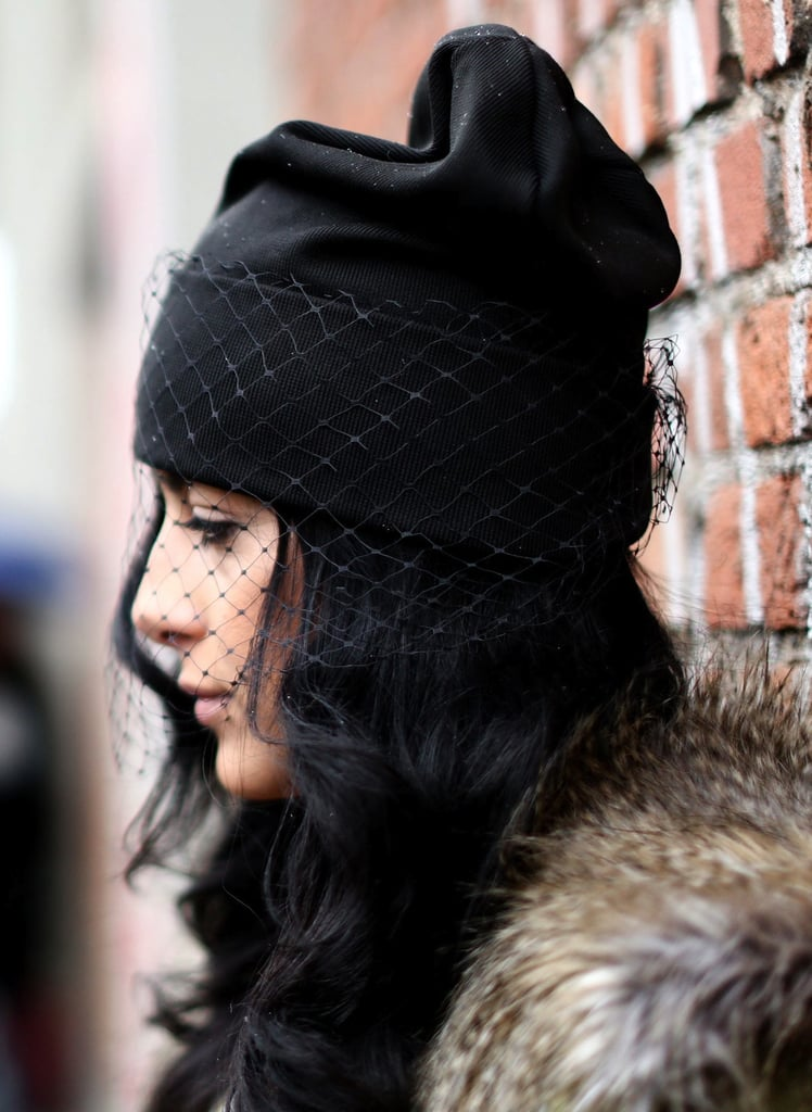 A style setter channeled Anna Dello Russo in a netted beanie.