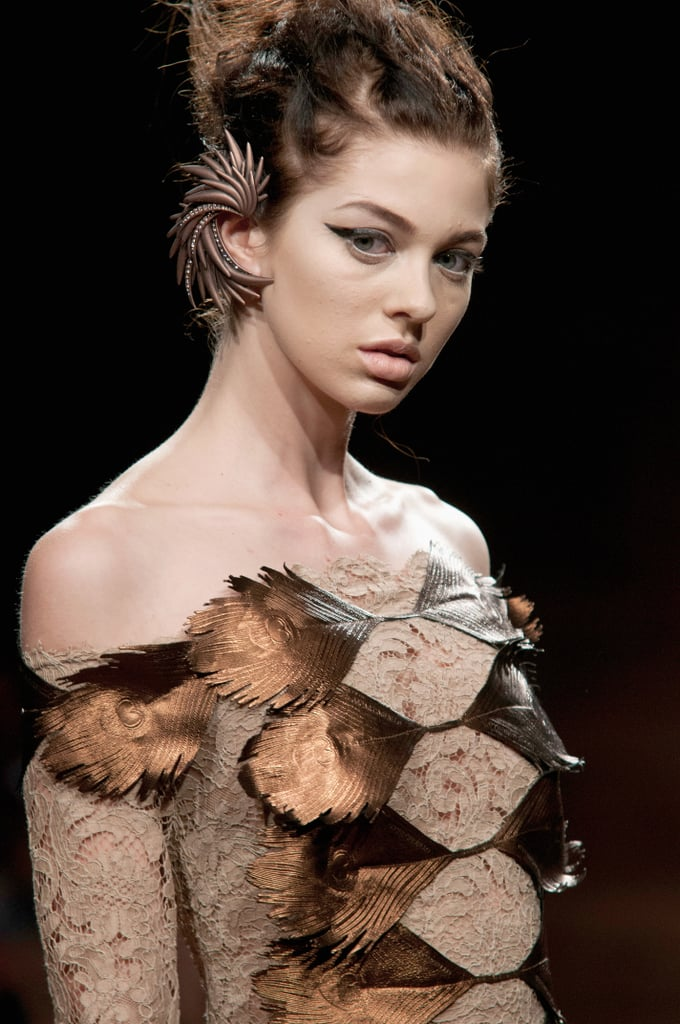 Feather accents made an impact on this Oscar Carvallo Haute Couture Fall 2013 dress.