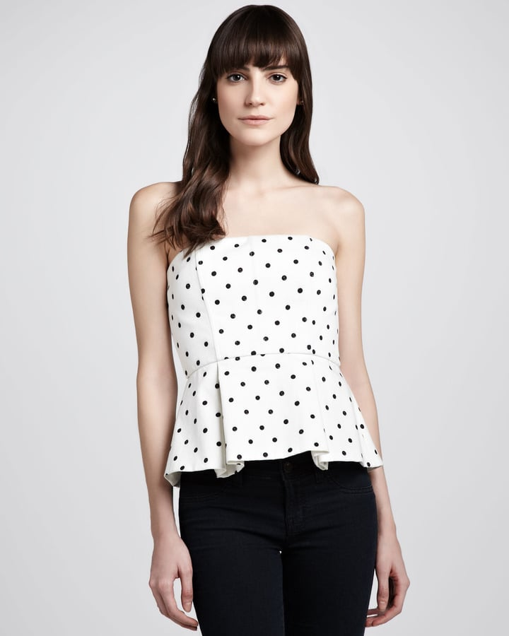 We love the slightly retro feel of this Alice + Olivia Sinclair Strapless Polka-Dot Peplum Top ($297).