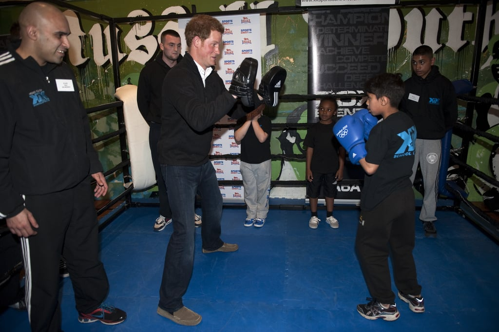 Prince Harry took on a young boy in the boxing ring in Nottingham, England.
