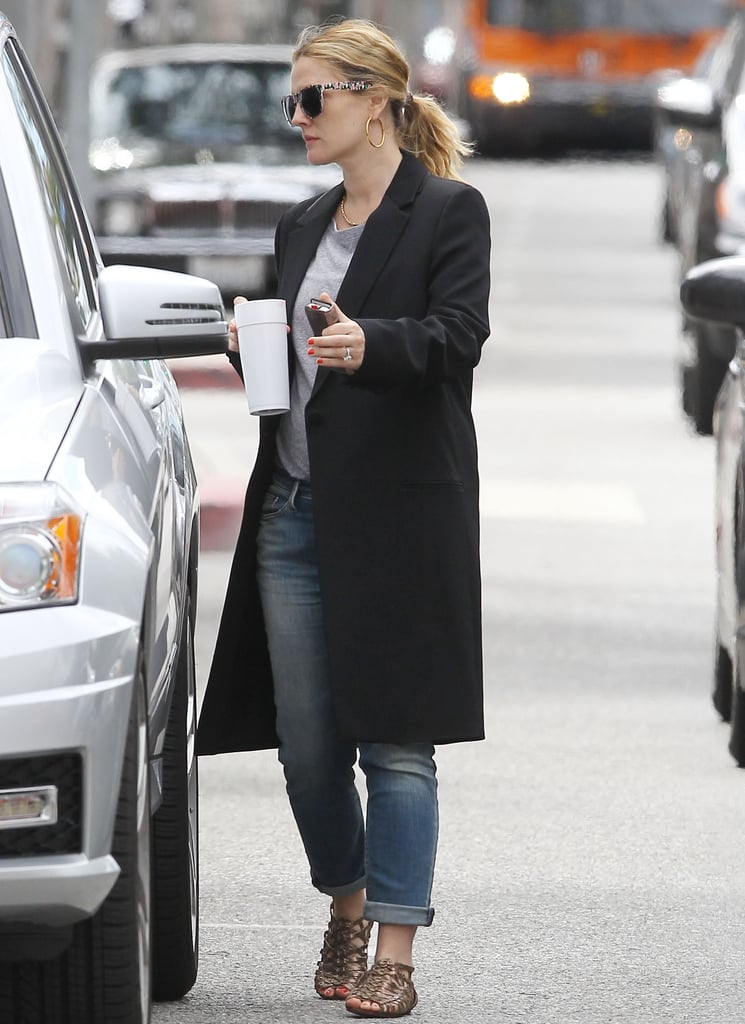 Drew Barrymore carried her phone and a cup as she left her office.