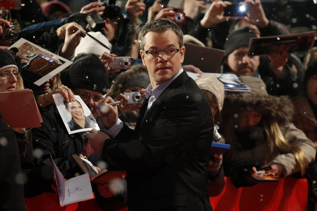 Matt Damon signed autographs Friday night on the red carpet.