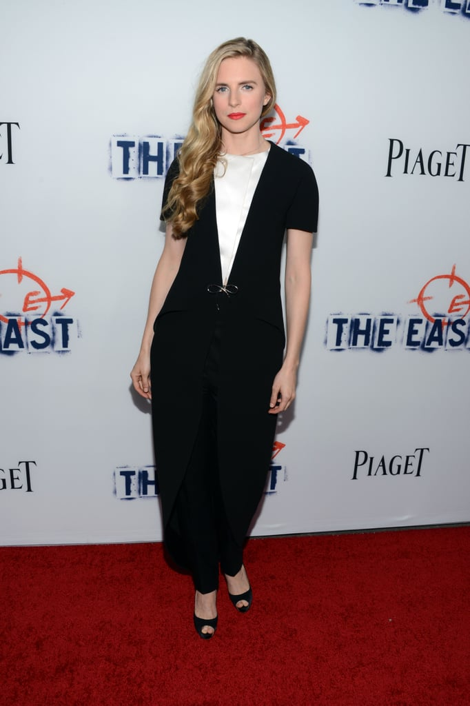 At The East premiere in Hollywood, Brit Marling was fashion forward in her black and white Balenciaga jumpsuit, which she polished up with red lips and peep-toe pumps.