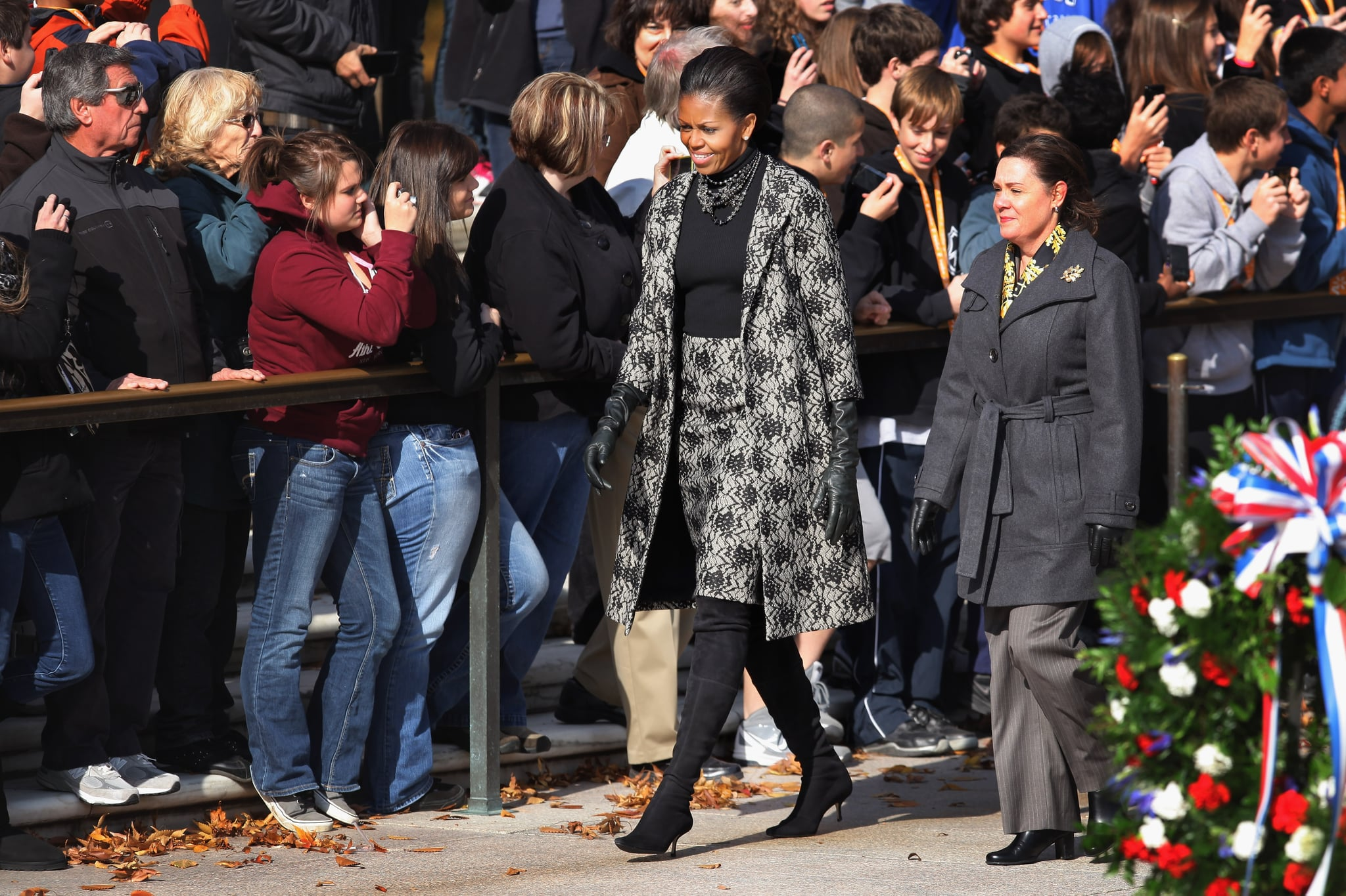 Michelle looked ultrachic in a black-and-gray printed coat and skirt on a cold DC day. She added knee-high black boots to finish off the look.