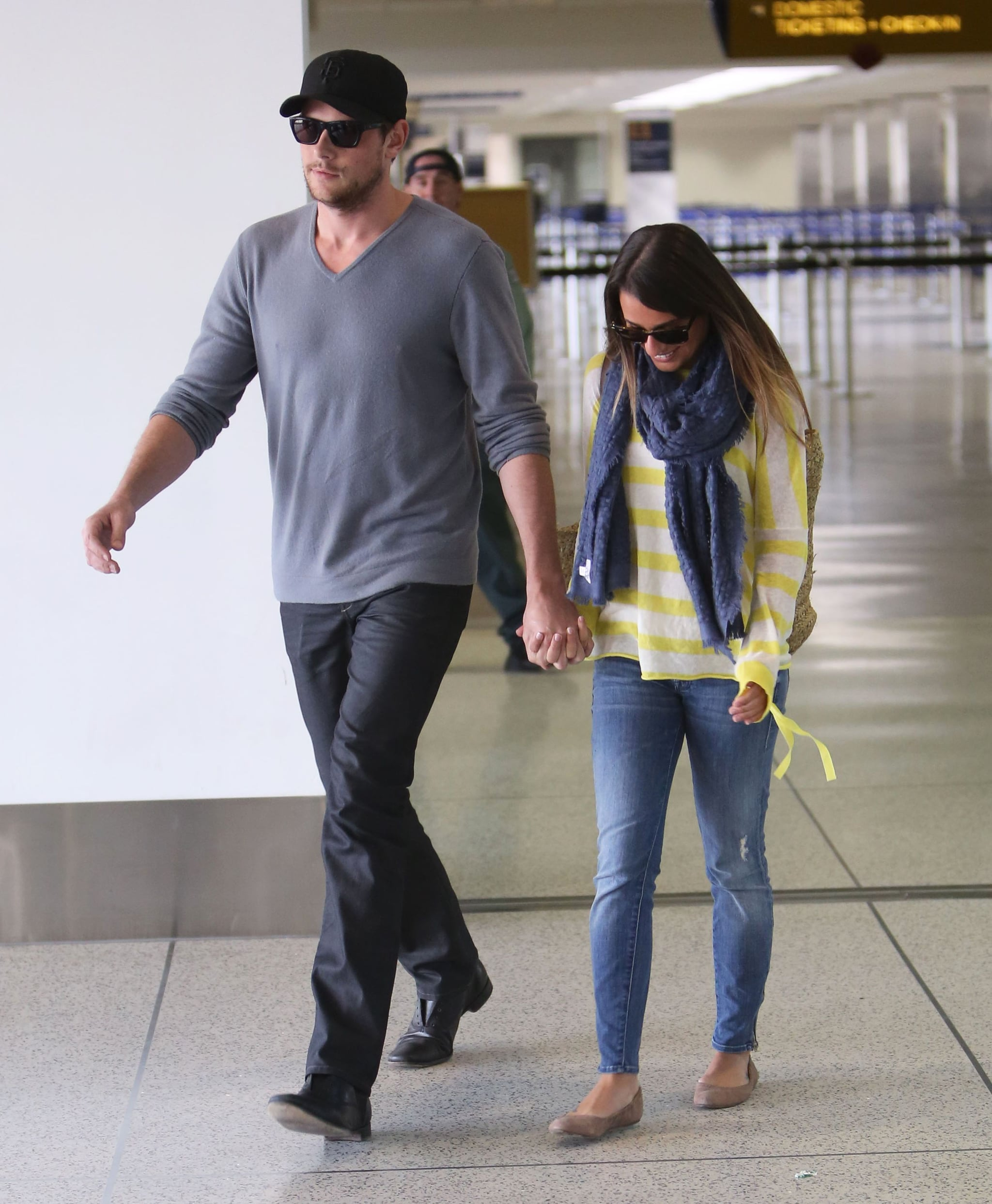 Lea Michele and Cory Monteith made their way through LAX together.