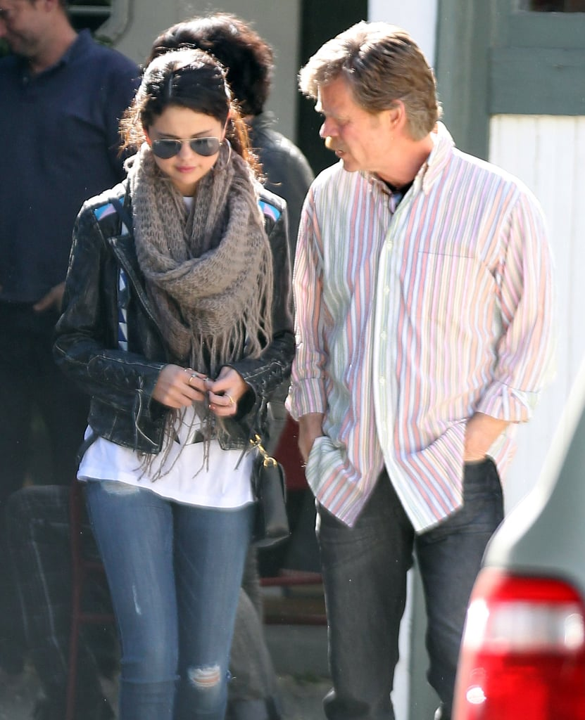 Selena Gomez wore a scarf and a leather jacket.
