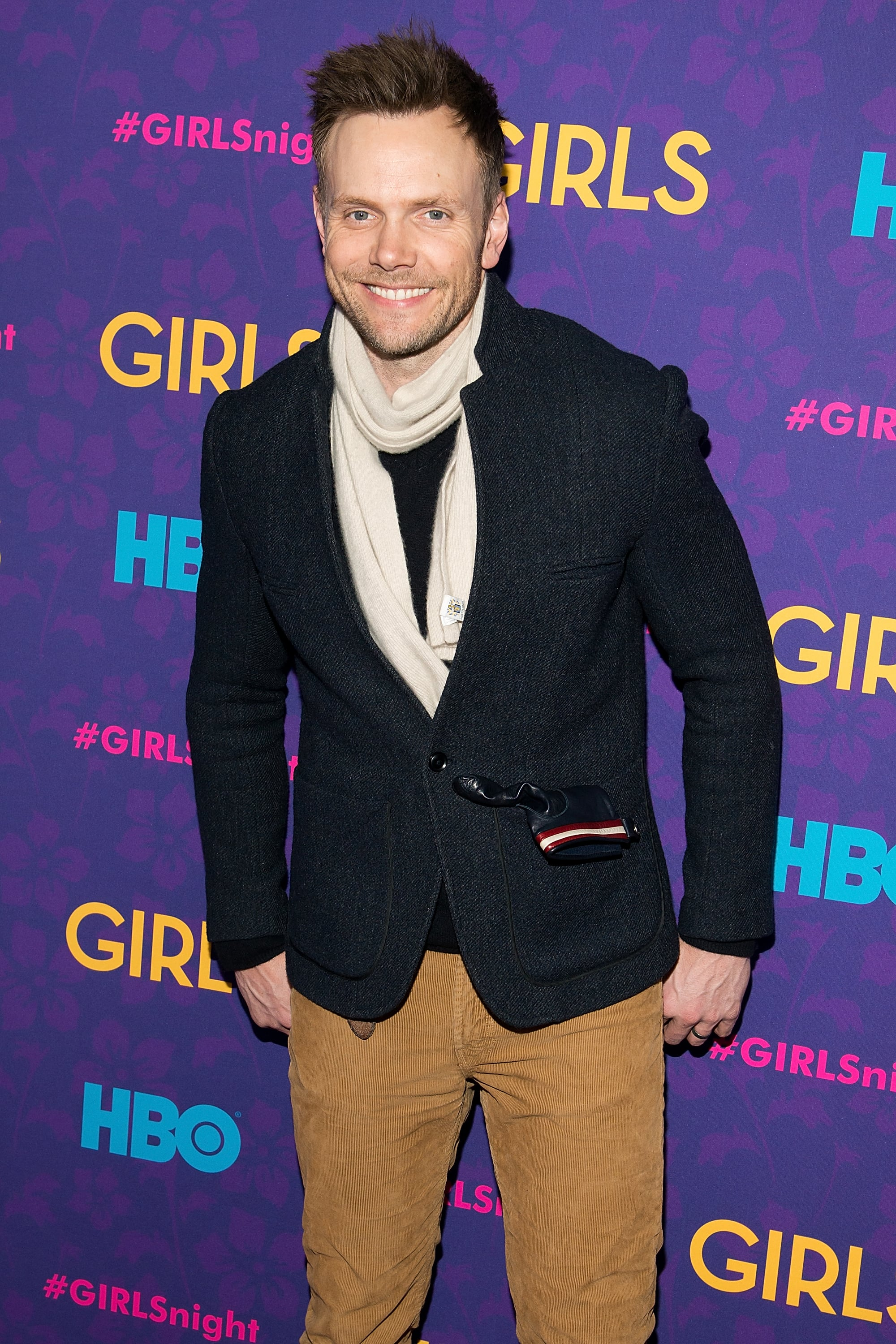 Joel McHale wore a scarf to the premiere.