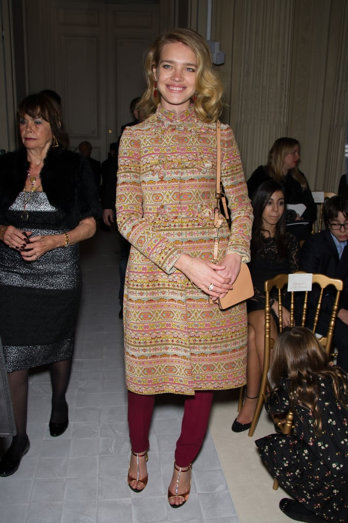 Natalia Vodianova smiled for the cameras in a printed coat and wine-colored trousers at Valentino.