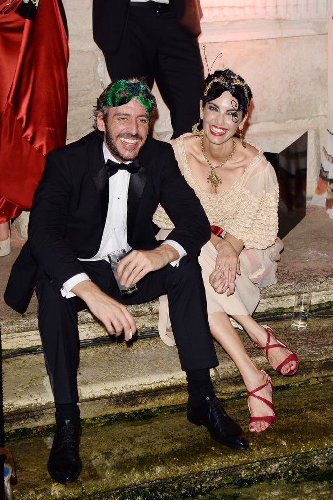 Giving their feet a rest, Alfonso de Borbon and Eugenia Silva unwound on the steps.