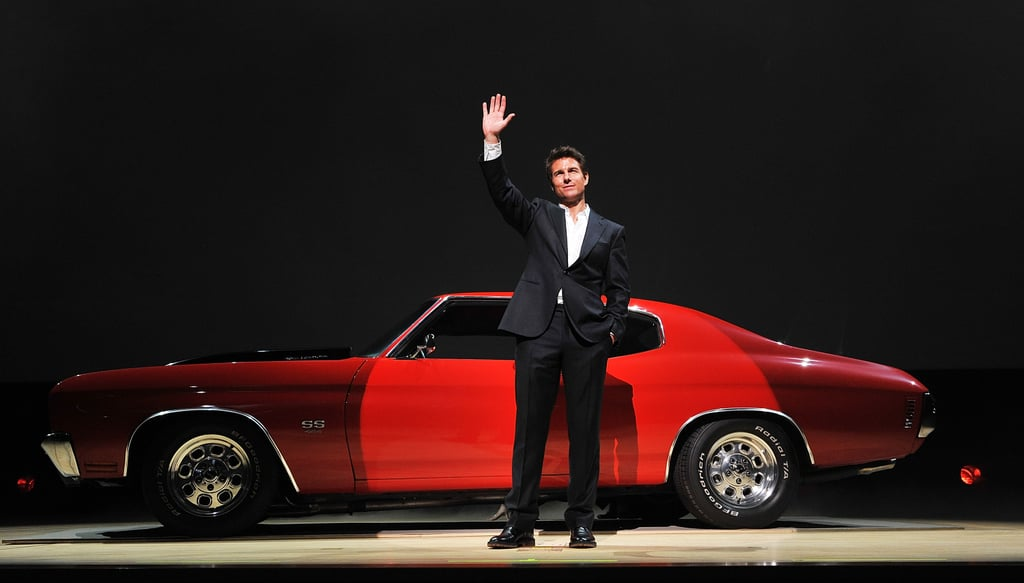 Tom Cruise posed in front of his Jack Reacher car.