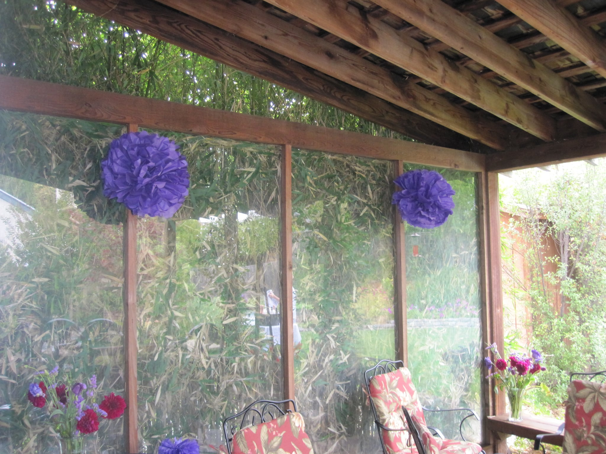 I love the way tissue paper dahilas look. I followed this easy how-to, but instead of wrapping the flowers around napkins, I hung them decoratively around the patio.