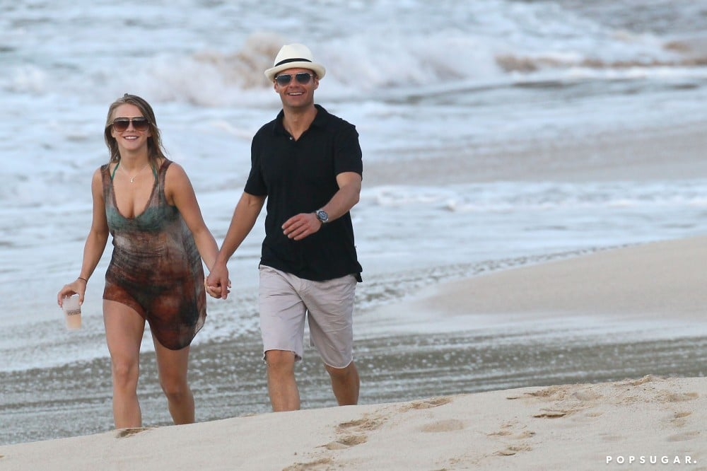 Ryan Seacrest and Julianne Hough held hands on the beach in St. Barts in January 2012.