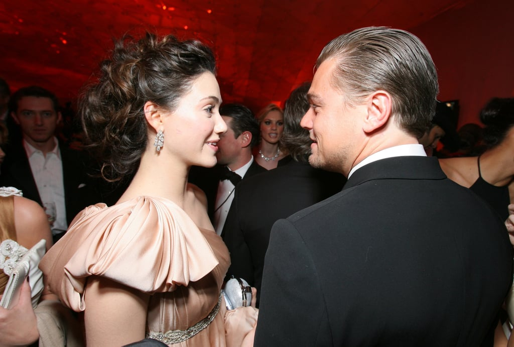 Leonardo DiCaprio shared a seemingly flirtatious moment with Emmy Rossum at the Vanity Fair Oscars afterparty in 2007.