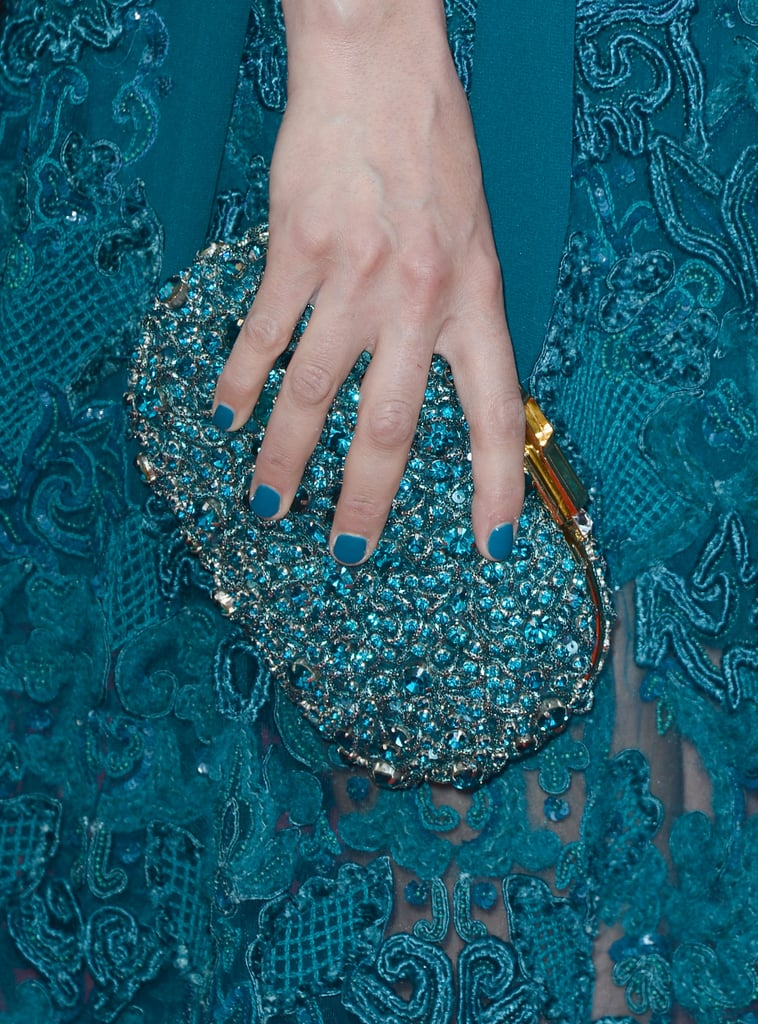Bérénice Bejo carried a jeweled turquoise clutch.