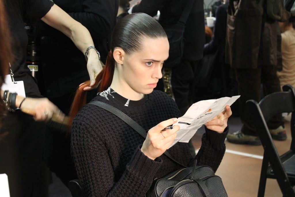 """Guido slicked on Redken's Hardware Gel in sections to ensure all hair was away from models' heads. """"The severity of the hair takes the personality away from the girls,"""" he said."""