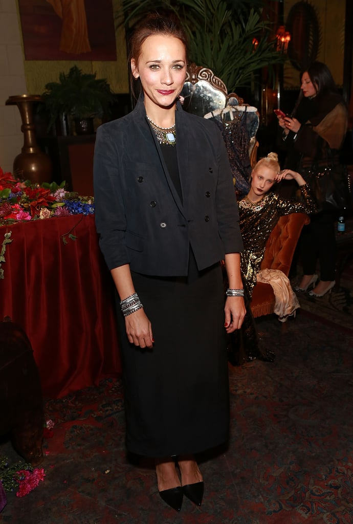 Rashida Jones went monochrome in a black maxi dress, a cropped jacket, and a few mixed metal accessories at the Dannijo presentation in NYC.
