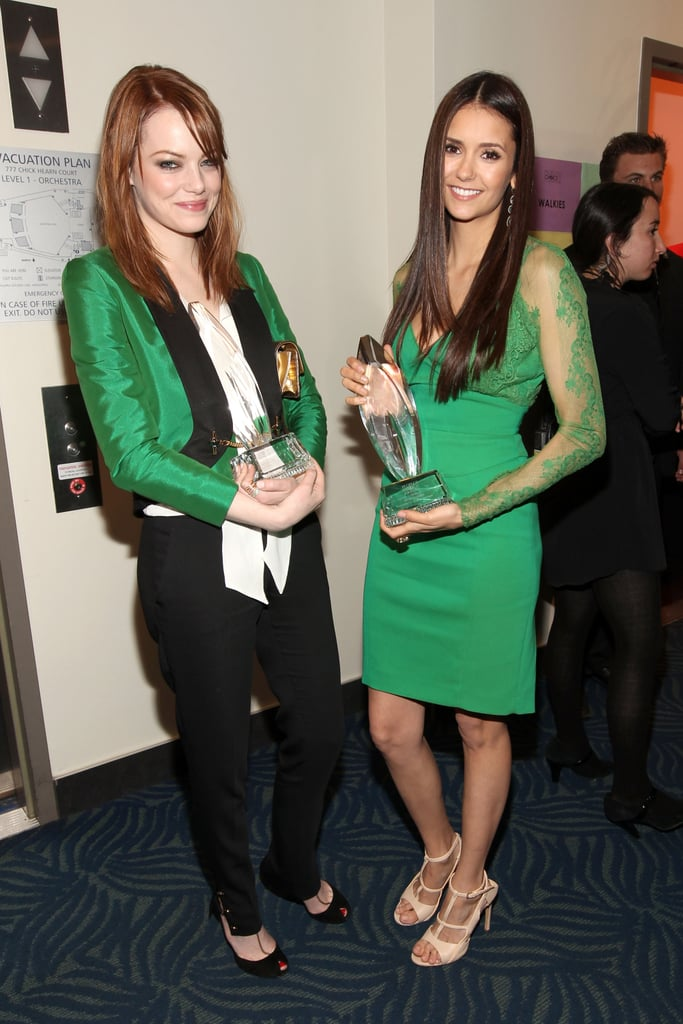 Nina Dobrev and Emma Stone checked out each other's People's Choice Awards.