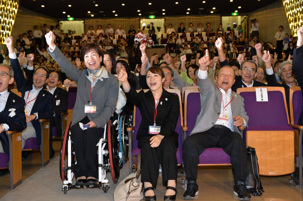 They all raised their hands to celebrate the Tokyo win.