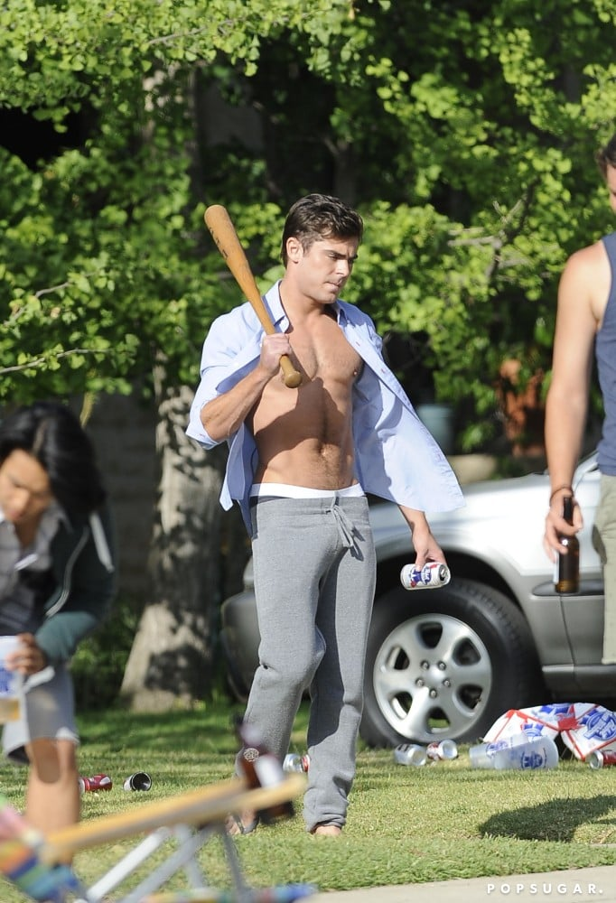 Zac Efron Flashes His Tanned Abs For the Cameras