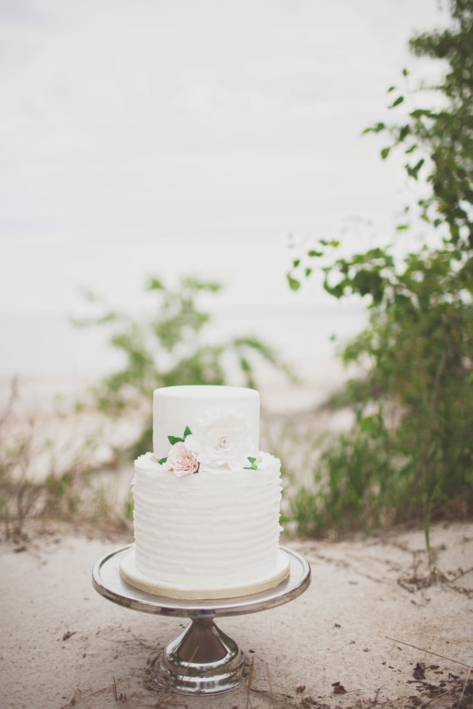 This two-layered ruffle and floral cake is effortless and elegant all at once; consider it a great option for beach weddings and beyond.