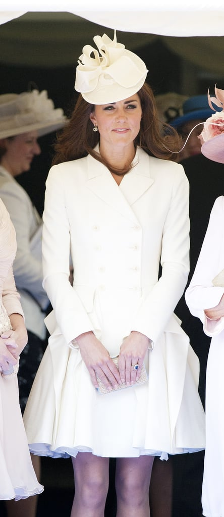 There's more white McQueen for Kate than that most famous floor-sweeper. For the Order of the Garter service, she picked a crisp style that fell above her knees.