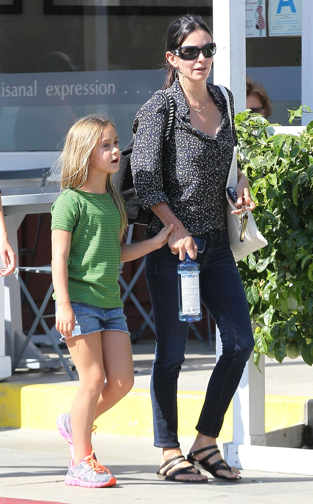 Courteney Cox held hands with daughter Coco on a shopping outing in LA.