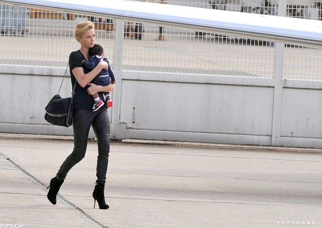 Charlize Theron wore black stilettos.
