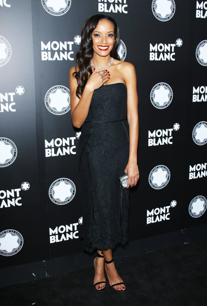 Selita Ebanks stepped out in a strapless, all-over lace dress that countered its sultry vibe with an ankle-length hem.