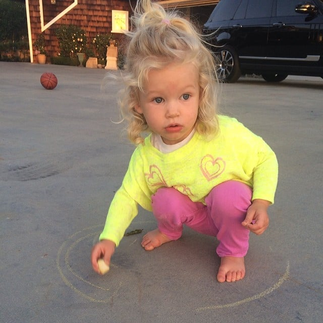 Maxwell Johnson ushered in Spring with some sidewalk chalk and a sweater her mom designed. Source: Instagram user jessicasimpson