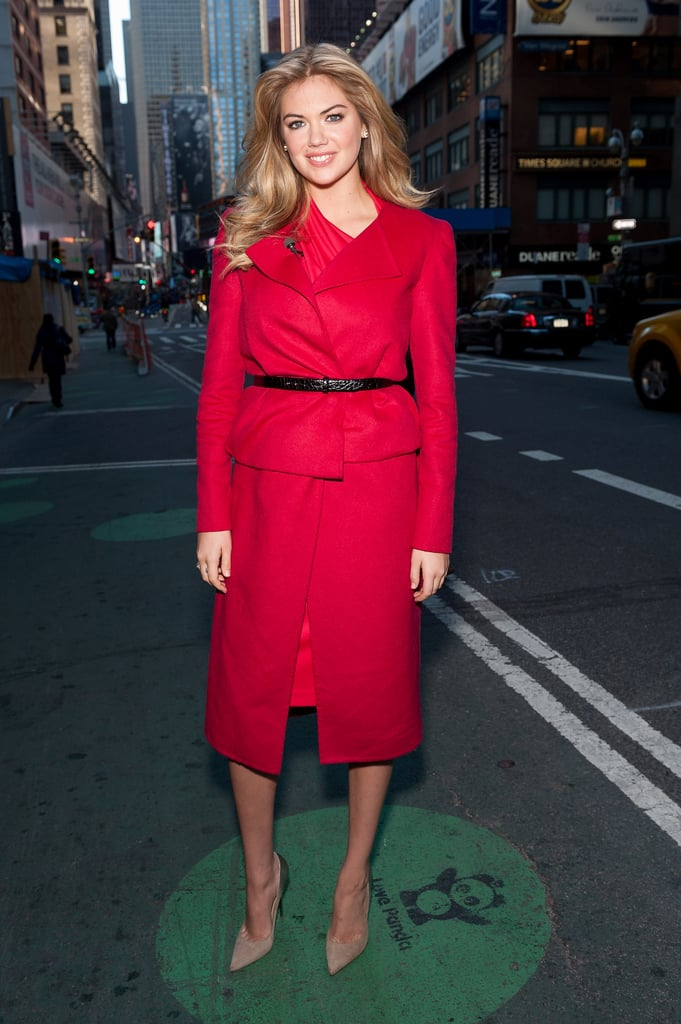 Model Kate Upton covered up in a cherry-red one-shoulder sheath and matching jacket in October 2013. Where to Wear: From carpool to the boardroom for the mom who does it all.