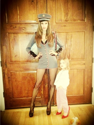 Alessandra Ambrosio dressed as a general and snapped a picture with her daughter before heading to a party in LA.  Source: Twitter user angelalessandra