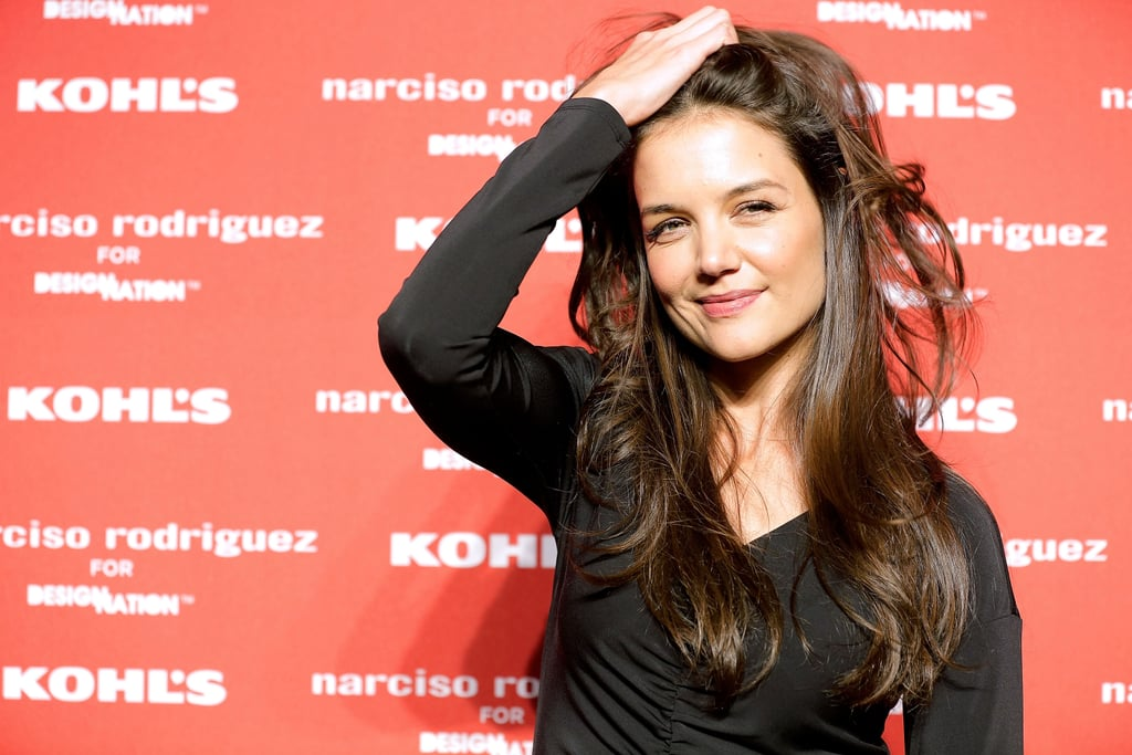 Katie Holmes played with her hair on the red carpet of Narciso Rodriguez's Kohl's collection launch party in NYC.