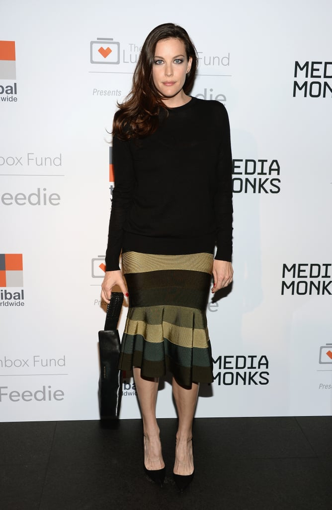 Liv Tyler paired separates for a formal look that would still work in the office. She topped her flared skirt off with a simple black top and finished everything with demure black accessories.