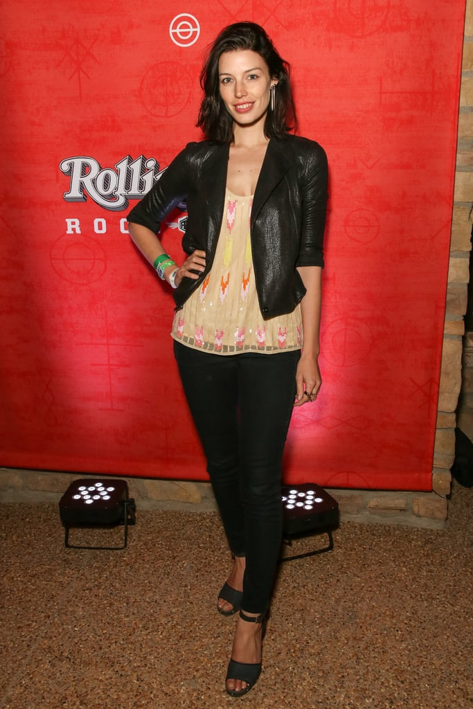 Jessica Paré kept it laid-back in a printed tank, a cropped black leather jacket, black skinny jeans, and ankle-strap sandals at the Diesel + Edun soiree.