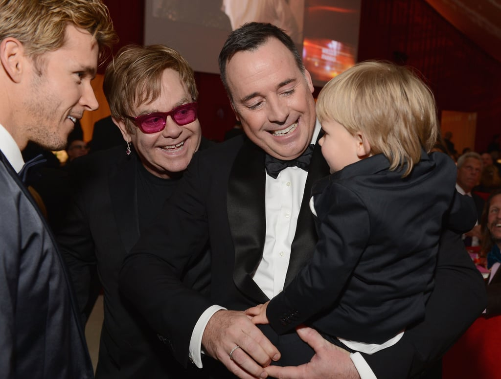 Elton John and David Furnish doted over their son Zachary at their Oscar party in LA.