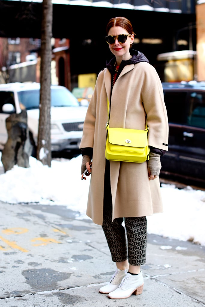 A flash of citron played up a camel coat on Christene Barberich.