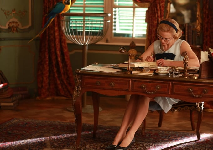 Grace sits down to write a letter.