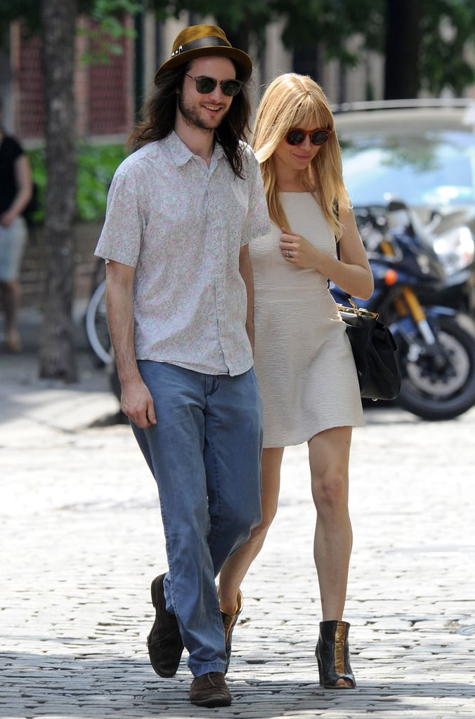 Sienna Miller wore a white sundress for a stroll with Tom Sturridge in the Big Apple.