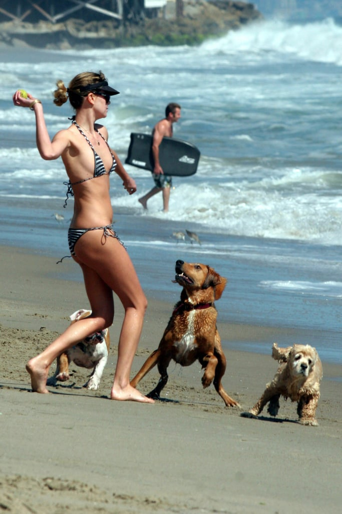 Charlize Theron wore a bikini with her pups on the beach in LA during August 2006.