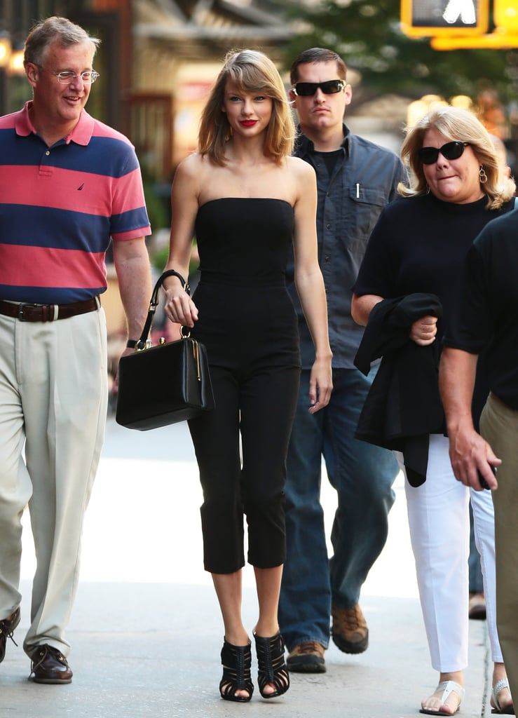 On Friday, Taylor Swift hit the streets of NYC with her parents, Scott Swift and Andrea Finlay.