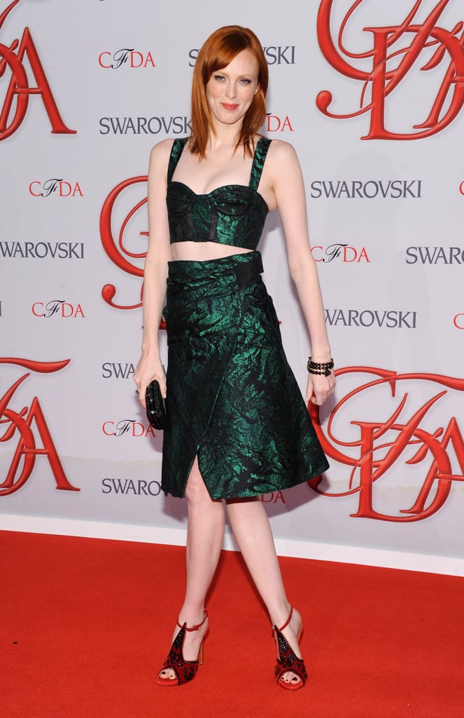 Karen Elson got in on the cropped trend with an emerald-green iteration, along with its matching knee-length skirt.