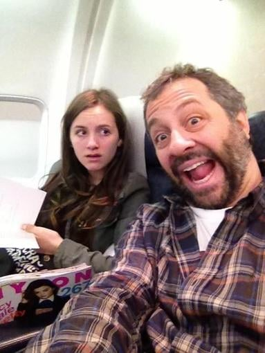 Judd Apatow took a photo while embarrassing his older daughter, Maude, during a plane ride. Source: Twitter user JuddApatow