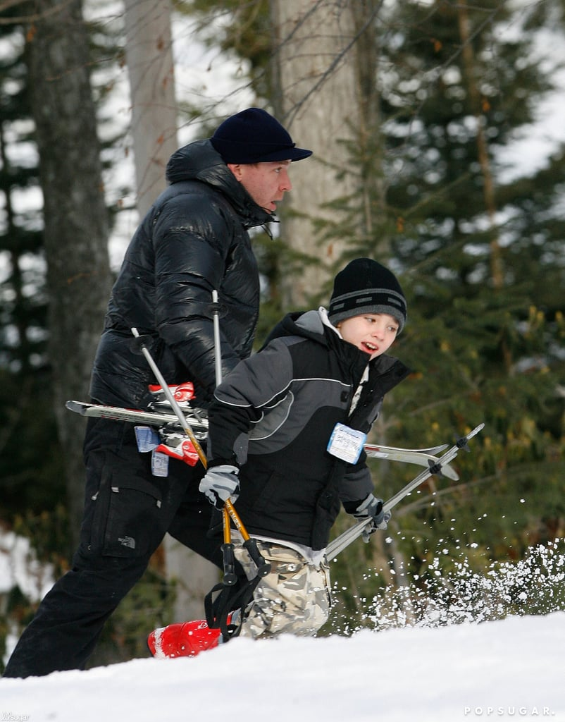 Guy Ritchie helped Rocco with his ski gear on the slopes in Pennsylvania in 2009.