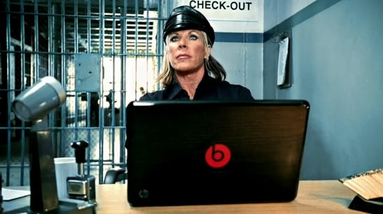 A Prison Guard Works on an HP Laptop