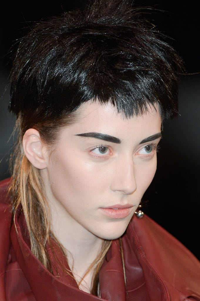 """Guido Palau, lead stylist for Redken, purposefully chose wigs for each of the girls that would clash, more or less subtly, with their natural hair color poking out from underneath for what he deemed a """"boyish, kind of punk quality."""""""