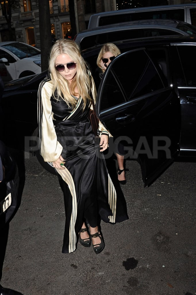 Mary-Kate and Ashley Olsen emerged from a car in Paris.